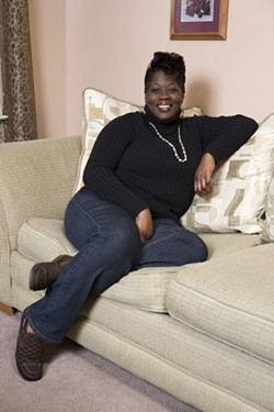 ANGUS LAMOND - AT HOME: Activist Devondia Roseborough relaxes in her West Charlotte home