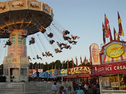 NORTH CAROLINA DEPARTMENT OF AGRICULTURE & CONSUMER SERVICES - At the North Carolina Mountain State Fair the smell from the food vendors wafts all the way to the tilt-a-whirl
