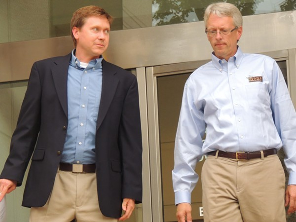 Attorney Russel Fergusson, left, and Todd Ford, co-owner of NoDa Brewery, leaving the City Council meeting Monday night.