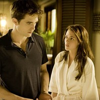 BAD ROMANCE: Things quickly turn problematic for the recently married Edward (Robert Pattinson) and Bella (Kristen Stewart) in The Twilight Saga: Breaking Dawn — Part 1.