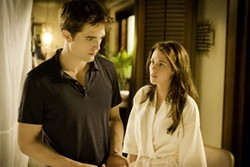 ANDREW COOPER / SUMMIT - BAD ROMANCE: Things quickly turn problematic for the recently married Edward (Robert Pattinson) and Bella (Kristen Stewart) in The Twilight Saga: Breaking Dawn — Part 1.