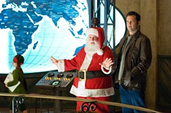 JAAP BUITENDIJK / WARNER BROS. - BASE OF OPERATIONS: Santa (Paul Giamatti) introduces Fred (Vince Vaughn) to the high-tech world of gift-giving in Fred Claus.