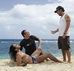 GLEN WILSON / UNIVERSAL STUDIOS - BEACH BLANKET BIMBO: Aldous (Russell Brand, left) and Peter (Jason Segel, center) receive no help from brain-dead surfer Chuck (Paul Rudd) in Forgetting Sarah Marshall.