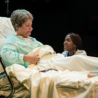 BEDSIDE MANNER: Maxine (Polly Adkins, left) and Tina (Nicole Watts) confer in Death Tax.