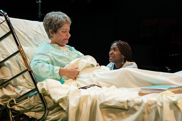 BEDSIDE MANNER: Maxine (Polly Adkins, left) and Tina (Nicole Watts) confer in Death Tax. - SHANNON J HAGER / XML PHOTOGRAPHY