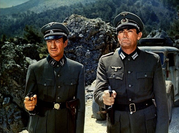 BEHIND ENEMY LINES: Miller (David Niven, left) and Mallory (Gregory Peck) pose as German officers in The Guns of Navarone. (Photo: Columbia)