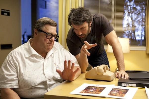 Ben Affleck (right) directs John Goodman on the set of Argo. - WARNER BROS.