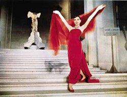 PARAMOUNT PICTURES - BETTER RED THAN WELL-READ: A bookworm (Audrey Hepburn) becomes a model in Funny Face.