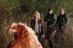 CHRIS HELCERMANAS-BENGE / UNIVERSAL - BEWARE! THE BLOB Starla Grant (Elizabeth Banks), Sheriff Bill Pardy (Nathan Fillion) and Officer Wally Whale (Don Thompson) are leery of getting slimed in Slither