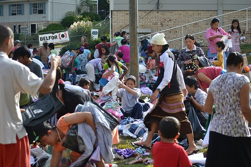 Birchcroft tenants sort clothes at a yard sale in front of the apartment complex.