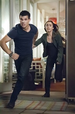 BRUCE TALAMON / LIONSGATE - BLAND ON THE RUN: Taylor Lautner and Lily Collins in Abduction