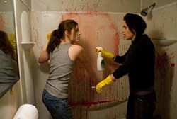 OVERTURE FILMS - BLOOD BATH: Amy Adams and Emily Blunt clean up in Sunshine Cleaning.