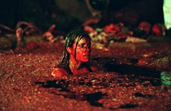 ALEX BAILEY / LIONS GATE - BLOOD BATH Sarah (Shauna Macdonald) sees red in The Descent
