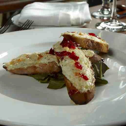 Blue Crab and ricotta crostini with a spicy chili jam.