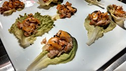 ALISON LEININGER - Braised chicken with apricot and sesame on lettuce found at Passion8 at its October preview night.