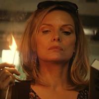 BURN, BABY, BURN: Michelle Pfeiffer lights up the screen in The Family. (Photo: Relativity Media)