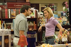 SUZANNE HANOVER / UNIVERSAL - BY THE BOOK Steve Carell tries to read Elizabeth Banks' body language in The 40-Year-Old Virgin