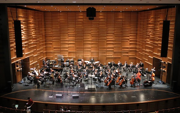 Charlotte Symphony Orchestra warms up in Knight Theaters new acoustic shell prior to last Saturday mornings LolliPops Concert.