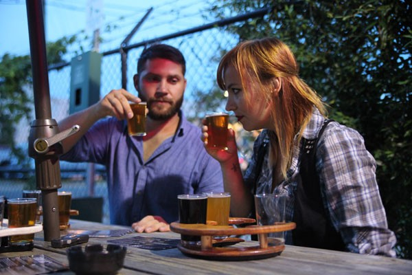 Chris Hendrickson and Dani Engle of Radio Lola sample the flavors of Triple C Brewing. - JEFF HAHNE