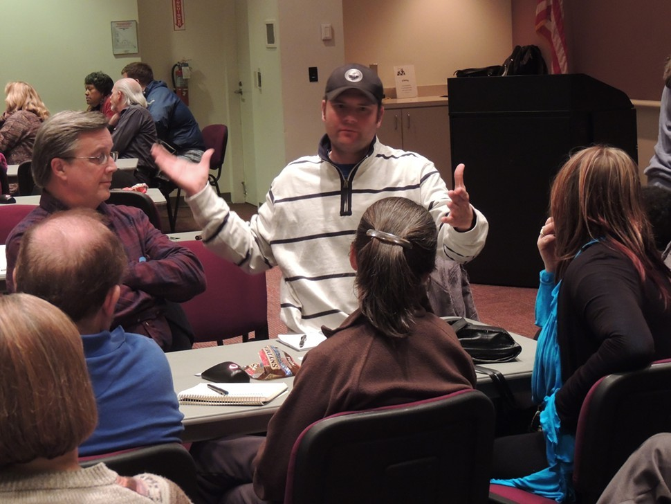 Chris Ingram, owner of Jack Beagles and Salvador Deli, addresses his group.