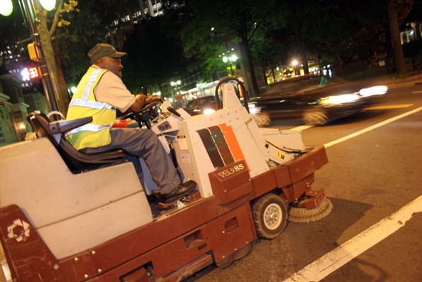 CLEANUP MAN: City employee Cald Welledward rides his sidewalk scrubber - CATALINA KULCZAR