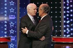 STAN HONDA - CLOSE TALKER: Rudy Giuliani (right) embraces John McCain