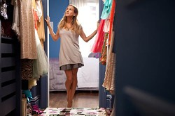 CRAIG BLANKENHORN / NEW LINE - CLOSET CASE: Carrie Bradshaw (Sarah Jessica Parker) admires her wardrobe in Sex and the City 2.