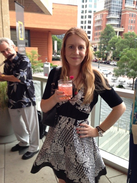 CLs assistant A&E editor Anita Overcash on the Halcyon patio, sipping a Cora Louise