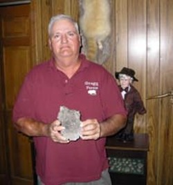 SAM BOYKIN - Clyde Gregg is proud of his trophies: an albino raccoon mounted to his wall - and his 50s-vintage nuclear bomb shrapnel.