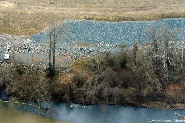 Coal ash spills into the Dan River.