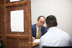 LOGAN CYRUS - Columbia, S.C., attorney Charles Phipps interviews a defendant at Charlotte's Immigration Court.