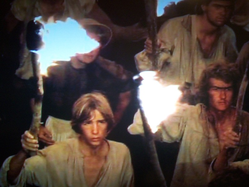 Creative Loafing film editor Matt Brunson (right) in a screen capture from the 1984 CBS miniseries Master of the Game.