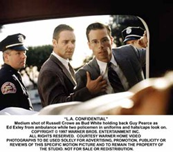 WARNER BROS. - CRIME SCENE: Bud White (Russell Crowe) and Ed Exley (Guy Pearce) head up the investigation in L.A. Confidential.