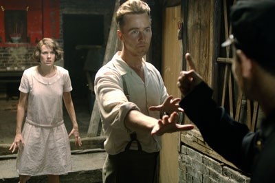 CULTURE CLASH Kitty (Naomi Watts) and Walter (Edward Norton) experience a run-in with a Chinese official in The Painted Veil. - WARNER INDEPENDENT