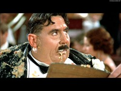 UNIVERSAL - CURIOUS GORGE: Mr. Creosote (Terry Jones) gets stuffed past the breaking point in Monty Python's The Meaning of Life.