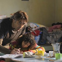 DADDY DAY CARE: Uxbal (Javier Bardem) lends his daughter (Hanaa Bouchaib) a helping hand in Biutiful.