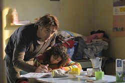 JOSE HARO / ROADSIDE ATTRACTIONS - DADDY DAY CARE: Uxbal (Javier Bardem) lends his daughter (Hanaa Bouchaib) a helping hand in Biutiful.