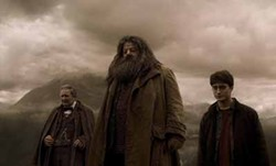 WARNER BROS. - DARK DAYS AHEAD: Professor Slughorn (Jim Broadbent), Hagrid (Robbie Coltrane) and Harry (Daniel Radcliffe) in Harry Potter and the Half-Blood Prince.