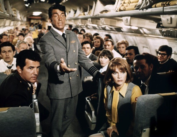 Dean Martin (standing) and Jacqueline Bisset in Airport (Photo: Universal)
