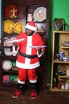 <p>DECISIONS, DECISIONS: Santa checks out the Tunisian tagines at Pura Vida Worldly Art.</p>