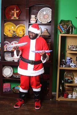 JASIATIC - DECISIONS, DECISIONS: Santa checks out the Tunisian tagines at Pura Vida Worldly Art.
