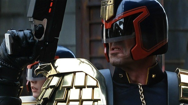 Diane Lane (background) and Sylvester Stallone in Judge Dredd (Photo: Disney)