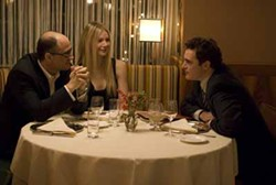 MAGNOLIA - DINNER COARSE: Leonard (Joaquin Phoenix, right) tries to hide his disgust over Michelle's (Gwyneth Paltrow) affair with a married man (Elias Koteas) in Two Lovers.