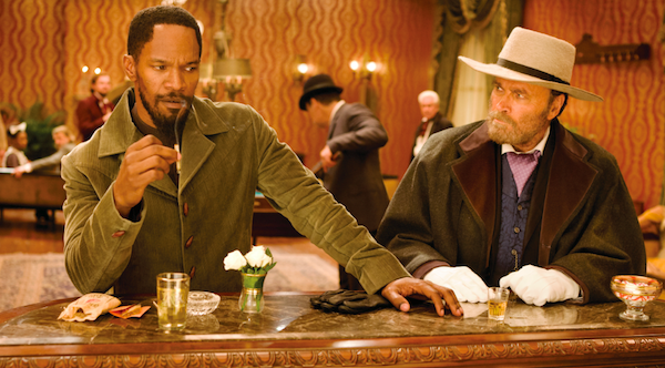 DJANGO, THEN AND NOW: The original screen Django, Franco Nero (right), chats with the new screen Django, Jamie Foxx, in Django Unchained. (Photo: Anchor Bay)