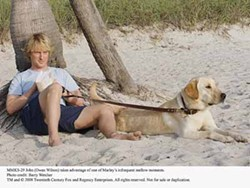 BARRY WETCHER / FOX & REGENCY - DOG DAY AFTERNOON: John (Owen Wilson) and Marley hang out at the beach in Marley & Me.