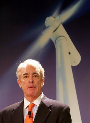 Duke Energy CEO Jim Rogers, beneath one of the wind turbines he says wont work in N.C.