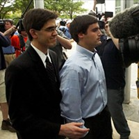 Duke lacrosse player David Evans escorted into the Durham County Detention Center after being indicted on sexual assault charges on May 15, 2006