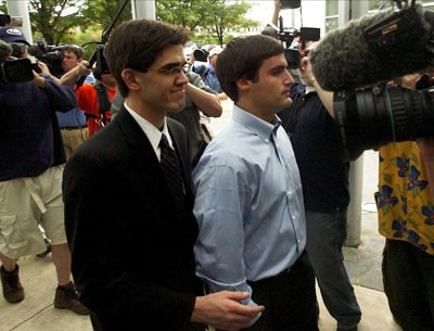 Duke lacrosse player David Evans escorted into the Durham County Detention Center after being indicted on sexual assault charges on May 15, 2006 - GETTY IMAGES