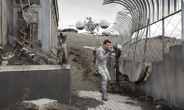 EMPIRE STATE OF MIND: A wary Jack (Tom Cruise) patrols the remains of a New York landmark in Oblivion. (Photo: Universal)