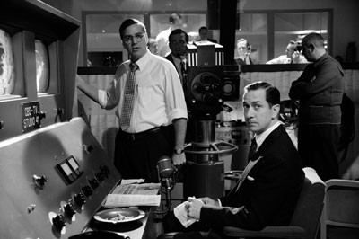 FACE THE NATION Fred Friendly (George Clooney) and Edward R. Murrow (David Strathairn) prepare to save America from itself in Good Night, And Good Luck (Warner)